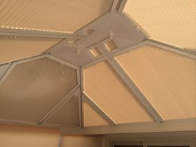 Conservatory blinds in warm colours in Suffolk - Conservatory Roof Blinds